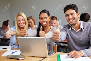 10681774-Successful-students-in-class-holding-thumbs-up-Stock-Photo-students-computer-training.jpg