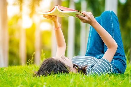 85118614-asian-teenage-girl-reading-a-book-in-the-park-on-sunday-morning-a-brilliant-weekend-the-women-studen.jpg